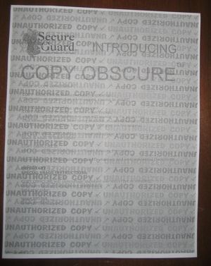 COPY OBSCURE when copied, a special embedded hidden message will appear on the photogopy.